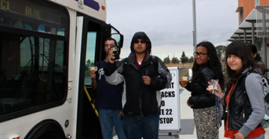 students taking the CatTracks bus for free with their CatCard